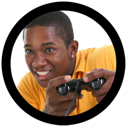 Photo of a smiling gamer holding a game pad